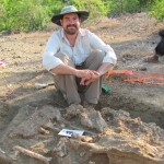 Adam Cossette at dig site