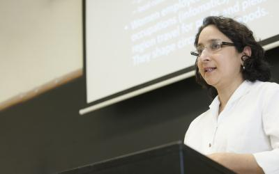 Professor Meena Khandelwal speaking at the front of a classroom.