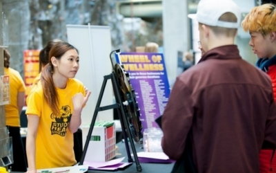 Student presenting information at a health fair booth