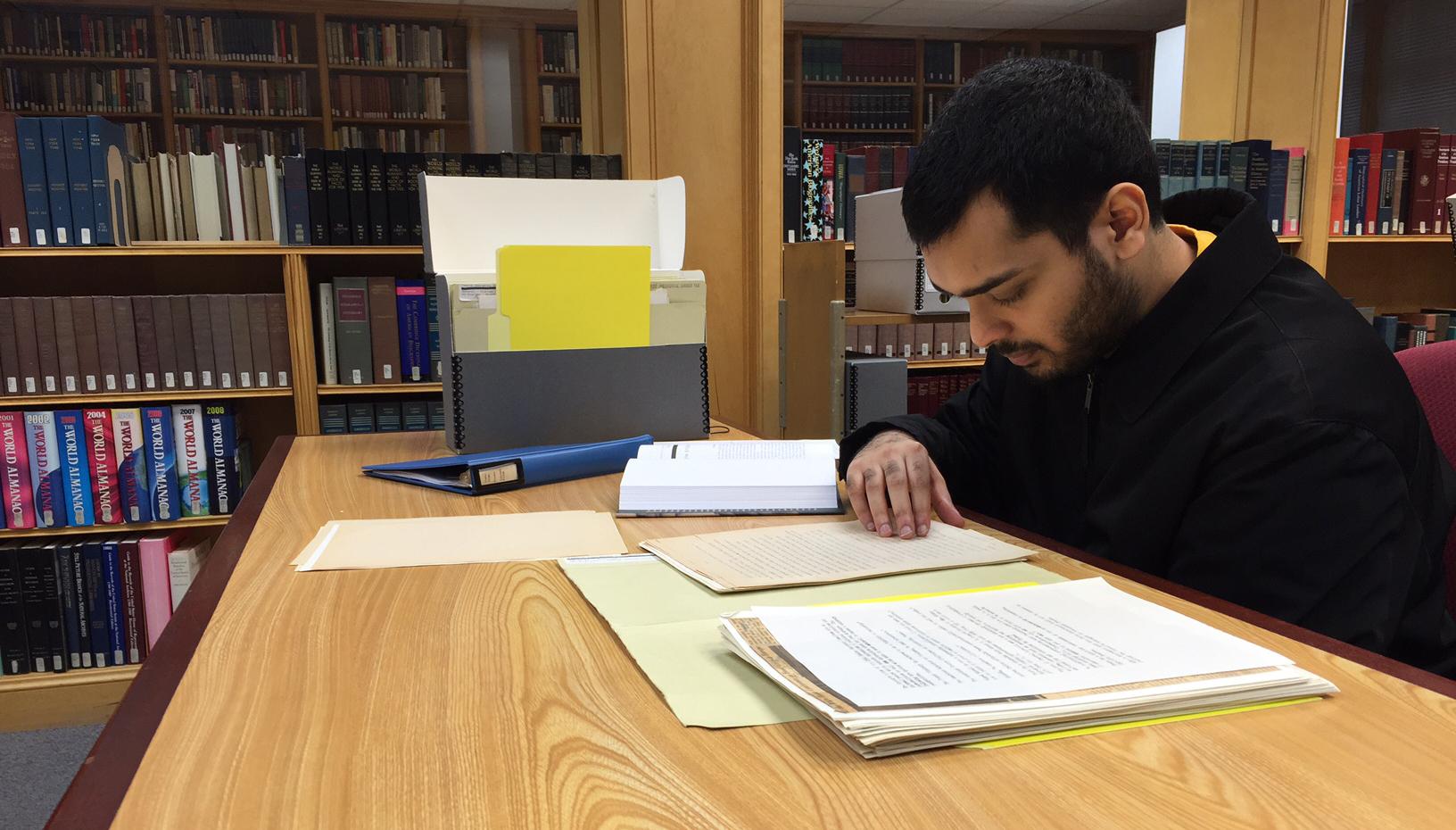 Undergraduate student reading.