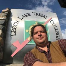 Jeremy Kingsbury in front of Leech Lake Tribal College