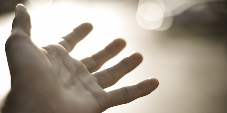 Image of a hand reaching outwards in an offer of help