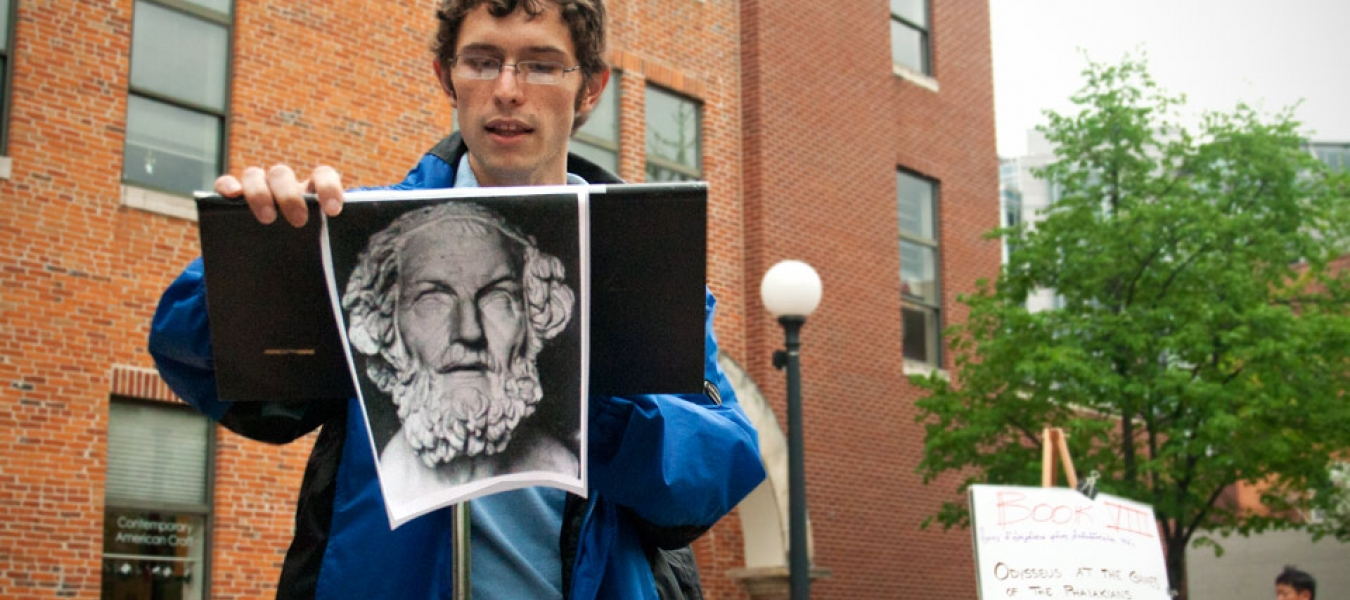 A student reads Plato in downtown Iowa City