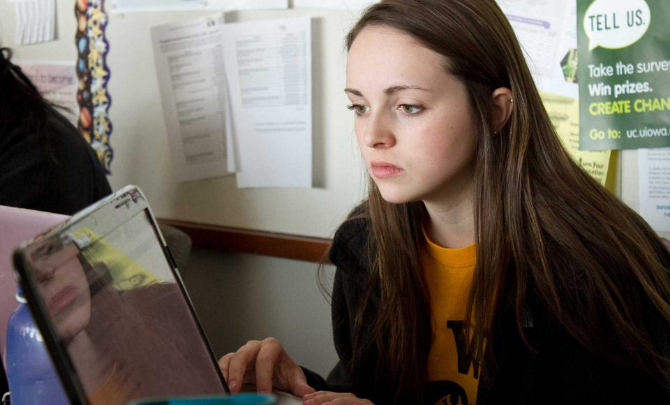 A student works on her laptop in class