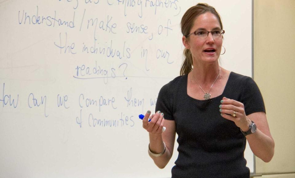 A professor teaching a class.