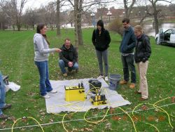 Students and faculty discussing a project on the campus of the University of Iowa
