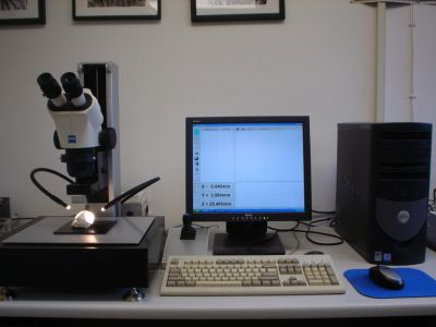 Reflex Microscope on a desk next to a computer