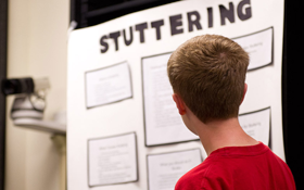Kyle Kopf gives a presentation on stuttering during a group counseling session.
