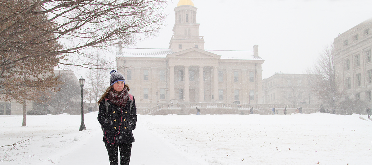 Girl walking on campus in snowy weather