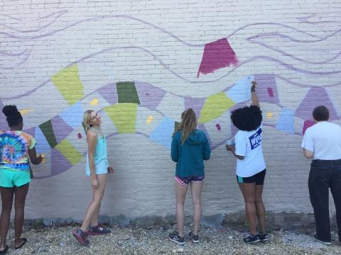 Public art mural in Clinton, Iowa painted by MFA student Ali Hval