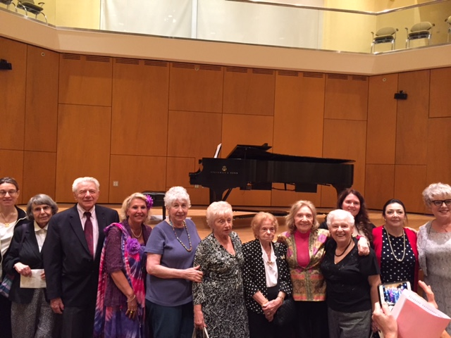 Group photo of musicians with Holocaust survivors