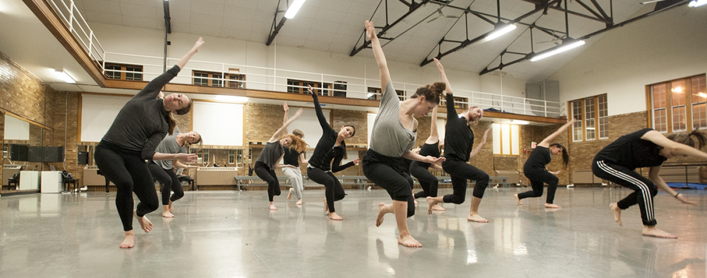 Dancers in company rehearsing for performance by the Dance department