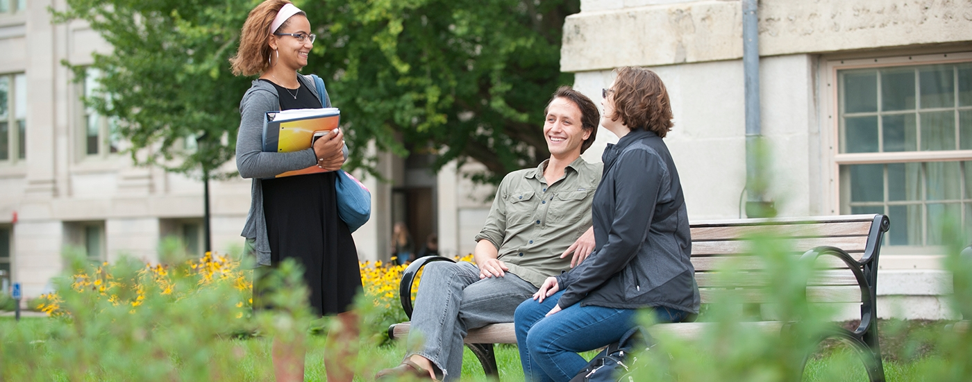 Graduate students talking on campus