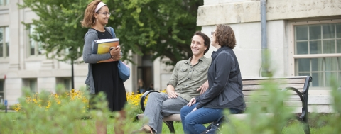 students talking in front of Old Cap