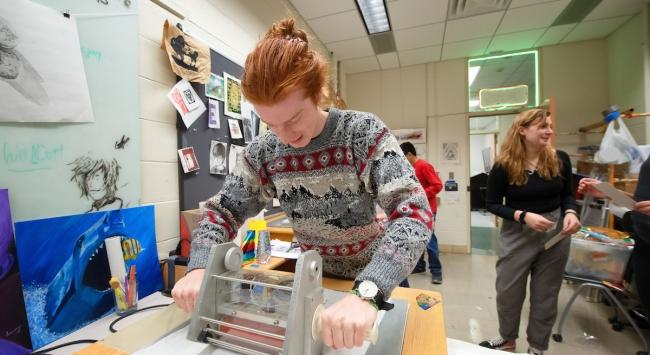 student using foil printer