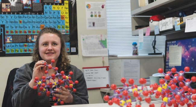 student with molecular models