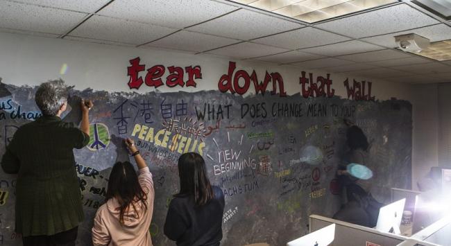 students at wall