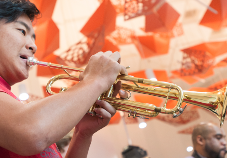 A student playing a trumpet.